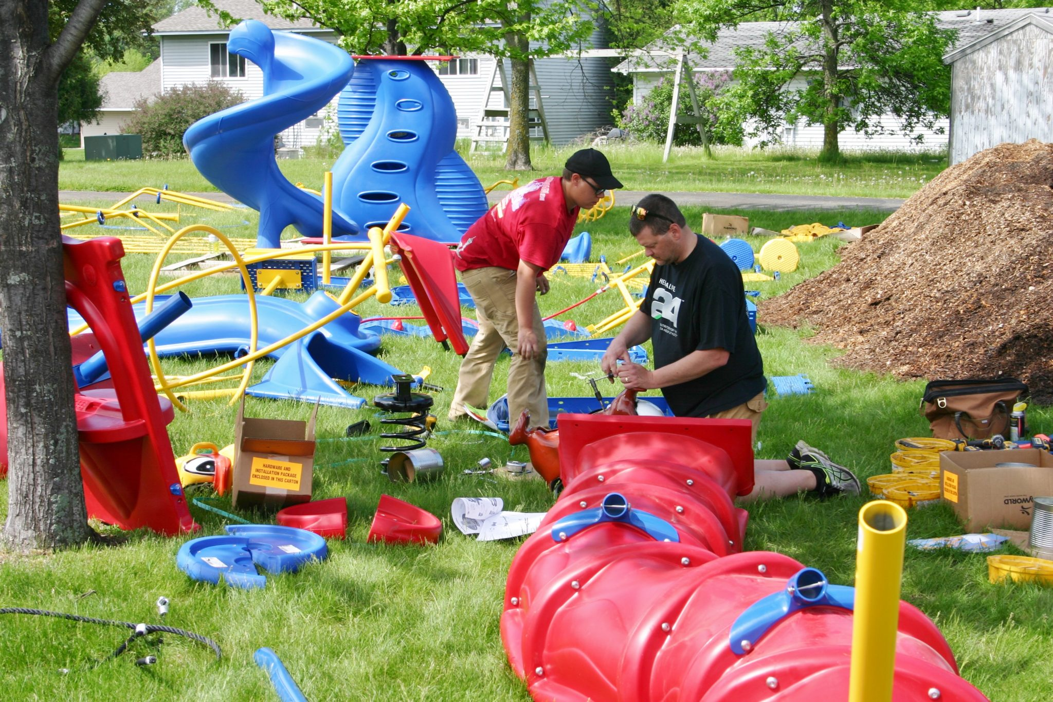 people building the playground equipment