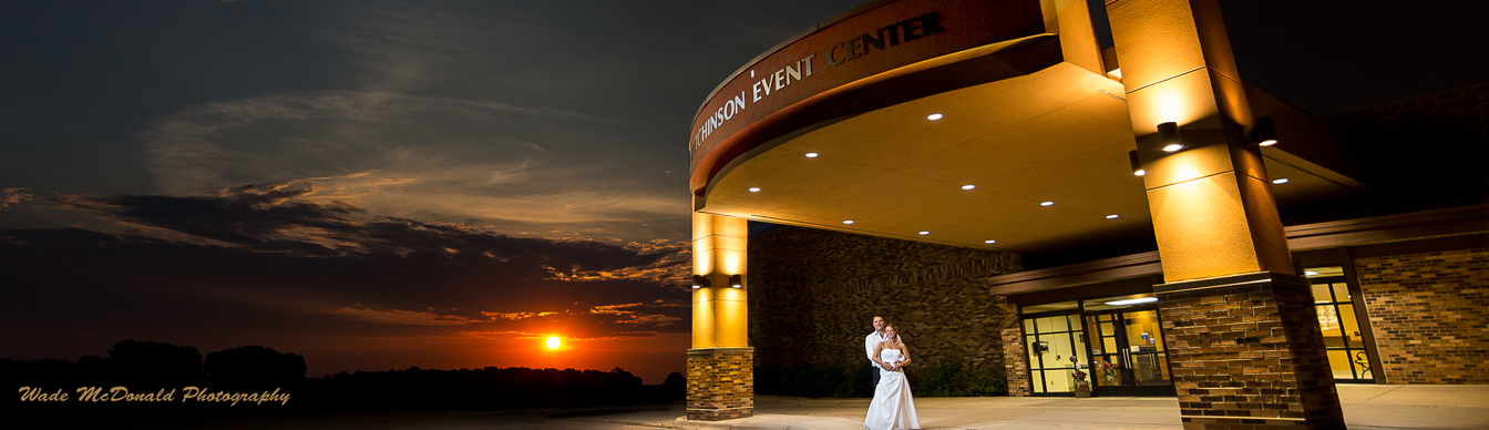 bride and groom outside of Hutchinson Event Center entrance